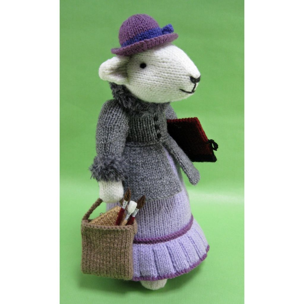 A photo of a knitted mouse named Beattie.