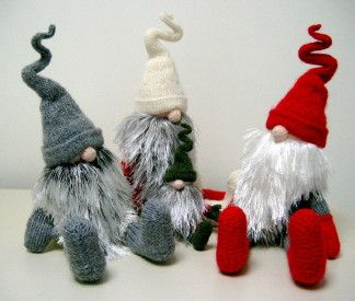 A photo of knitted Jultomtar trio by Alan Dart