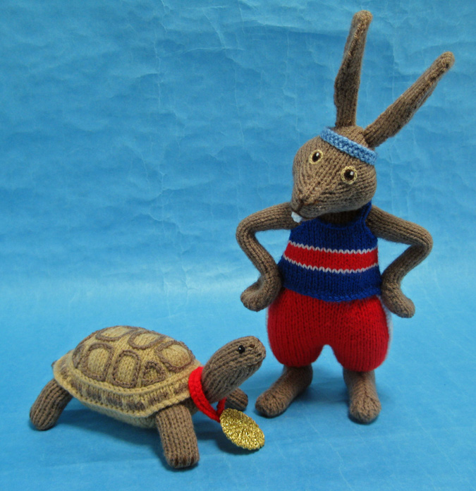 A photo of the knitted Tortoise and Hare by Alan Dart